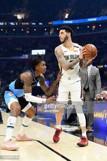 Kevin Porter Jr #4 of the Cleveland Cavaliers guards Collin Sexton of the Cleveland Cavaliers during the first half at Rocket Mortgage Fieldhouse on...