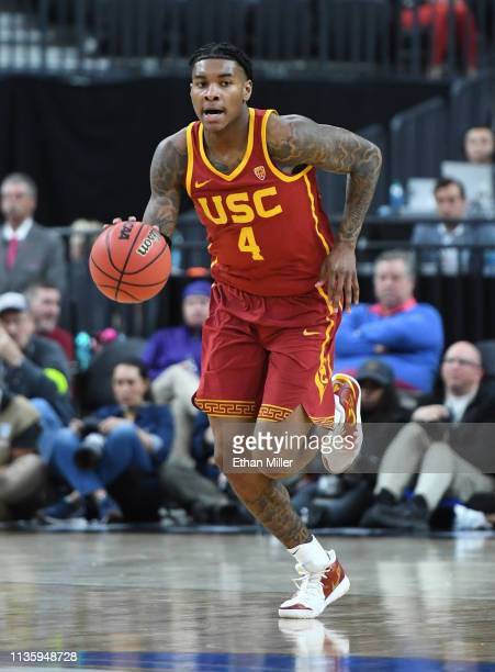 Kevin Porter Jr #4 of the USC Trojans brings the ball up the court against the Washington Huskies during a quarterfinal game of the Pac12 basketball...