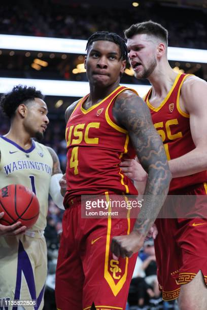 Kevin Porter Jr #4 of the USC Trojans celebrates with Nick Rakocevic of the USC Trojans after dunk against the Washington Huskies during a...