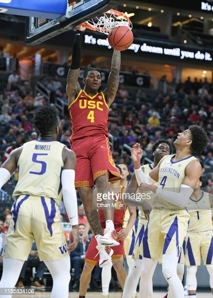 Kevin Porter Jr #4 of the USC Trojans dunks against the Washington Huskies during a quarterfinal game of the Pac12 basketball tournament at TMobile...