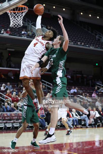 Kevin Porter Jr. #4 of the USC Trojans goes for the dunk against Adam Webb of the Stetson Hatters during a college basketball game at Galen Center on...