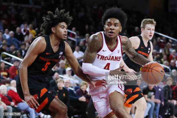 Kevin Porter Jr #4 of the USC Trojans handles the ball against Ethan Thompson of the Oregon State Beavers during a college basketball game at Galen...