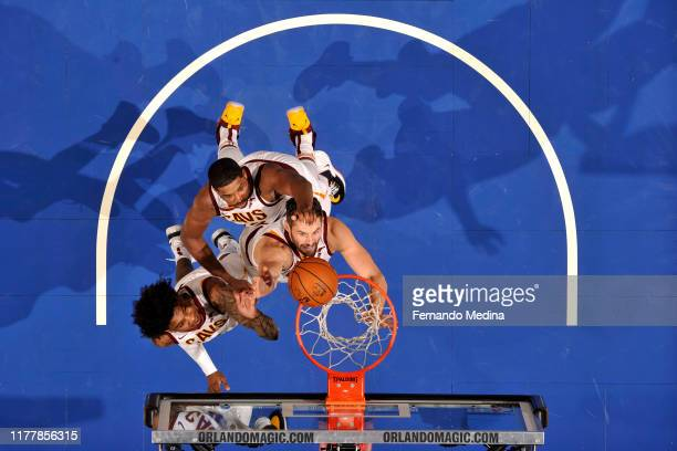 Kevin Porter Jr #4 Tristan Thompson and Kevin Love of the Cleveland Cavaliers go up for the rebound against the Orlando Magic on October 23 2019 at...