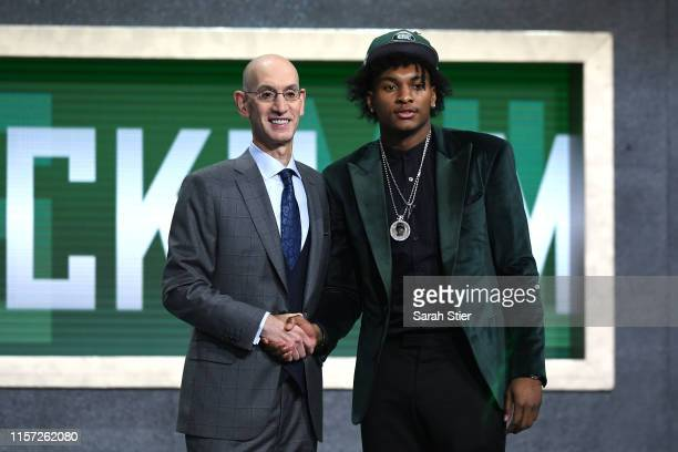 Kevin Porter Jr poses with NBA Commissioner Adam Silver after being drafted with the 30th overall pick by the Milwaukee Bucks during the 2019 NBA...