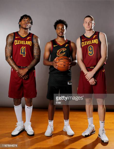 Kevin Porter JrDarius Garland and Dylan Windler of the Cleveland Cavaliers pose for a portrait during the 2019 NBA Rookie Photo Shoot on August 11...