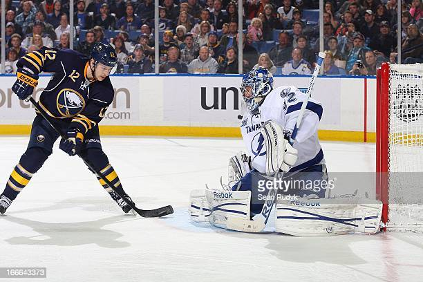 Kevin Porter of the Buffalo Sabres scores a second period goal against Mathieu Garon of the Tampa Bay Lightning on April 14 2013 at the First Niagara...