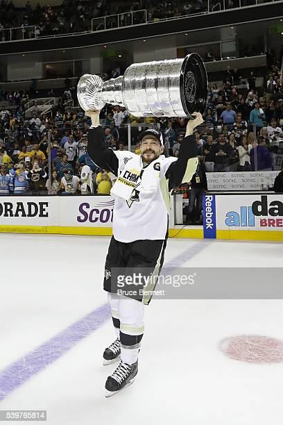 Kevin Porter of the Pittsburgh Penguins celebrates by hoisting the Stanley Cup after a 31 victory over the San Jose Sharks in Game Six of the 2016...