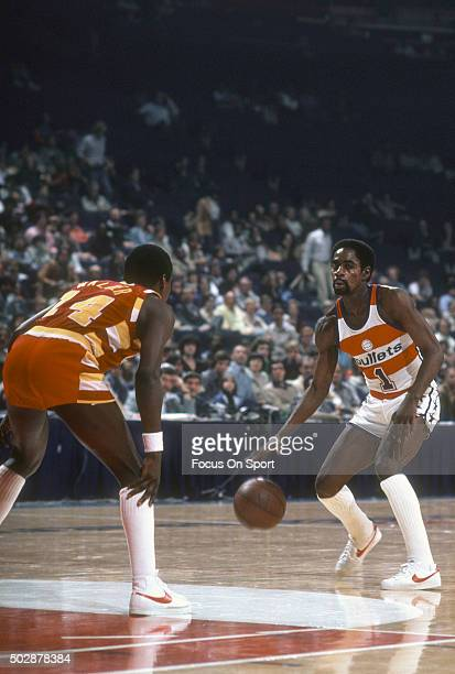 Kevin Porter of the Washington Bullets dribbles the ball while guarded by Foots Walker of the Cleveland Cavaliers during an NBA basketball game circa...