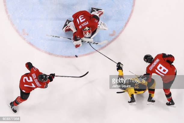 Kevin Poulin of Canada defends against Marcel Goc of Germany during the Men's Playoffs Semifinals on day fourteen of the PyeongChang 2018 Winter...