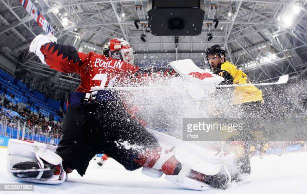 Kevin Poulin of Canada defends against Marcus Kink of Germany during the Men's Playoffs Semifinals on day fourteen of the PyeongChang 2018 Winter...