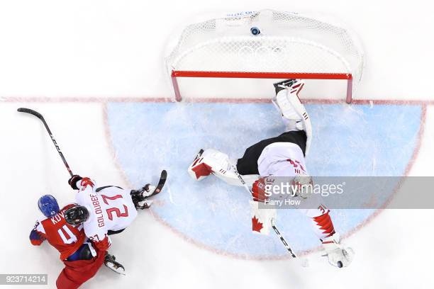 Kevin Poulin of Canada makes a save against Jan Kovar of the Czech Republic in the second period during the Men's Bronze Medal Game on day fifteen of...