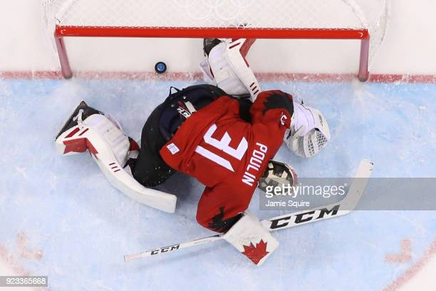Kevin Poulin of Canada reacts to a goal by Frank Mauer of Germany in the second period during the Men's Playoffs Semifinals on day fourteen of the...
