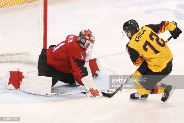 Kevin Poulin of Canada stops a penalty shot by Dominik Kahun of Germany in the third period during the Men's Playoffs Semifinals on day fourteen of...