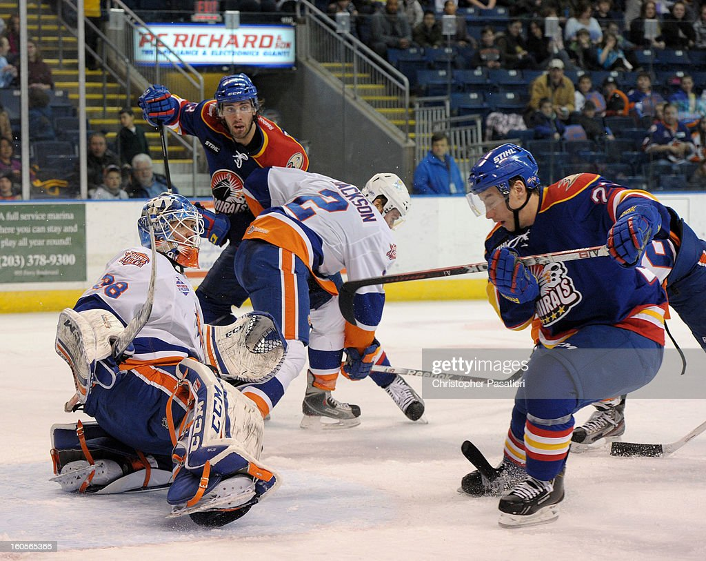 Kevin Poulin #38 of the Bridgeport Sound Tigers looks up after deflecting a shot on goal during an American Hockey League against the Norfolk Admirals game on February 2, 2013 at the Webster Bank Arena at Harbor Yard in Bridgeport, Connecticut.