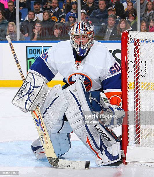 Kevin Poulin of the New York Islanders tends goal against the Buffalo Sabres at HSBC Arena on January 21, 2011 in Buffalo, New York.