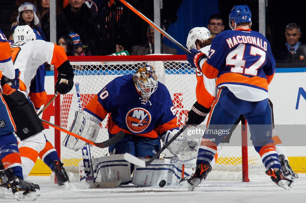 Kevin Poulin #60 of the New York Islanders tends net against the Philadelphia Flyers at the Nassau Veterans Memorial Coliseum on October 26, 2013 in Uniondale, New York. The Flyers defeated the Islanders 5-2.
