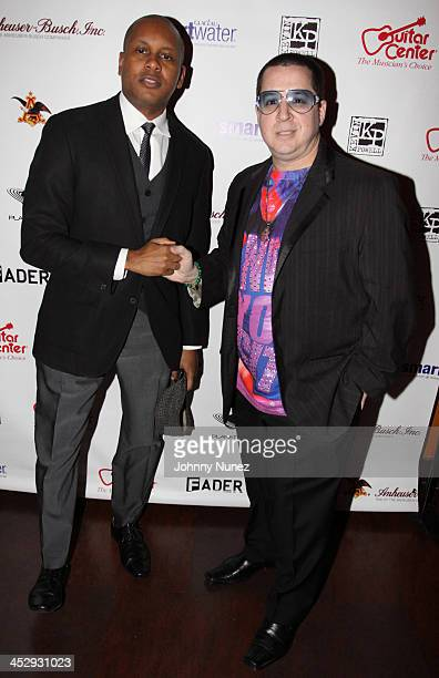 Kevin Powell and artist Noah G Pop attend Kevin Powell's 9th annual holiday party and clothing drive at Tribeca Cinemas on December 11 2009 in New...