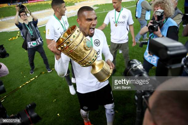 Kevin Prince Boateng celebrates with the DFB Cup trophy after winning the DFB Cup final against Bayern Muenchen at Olympiastadion on May 19 2018 in...