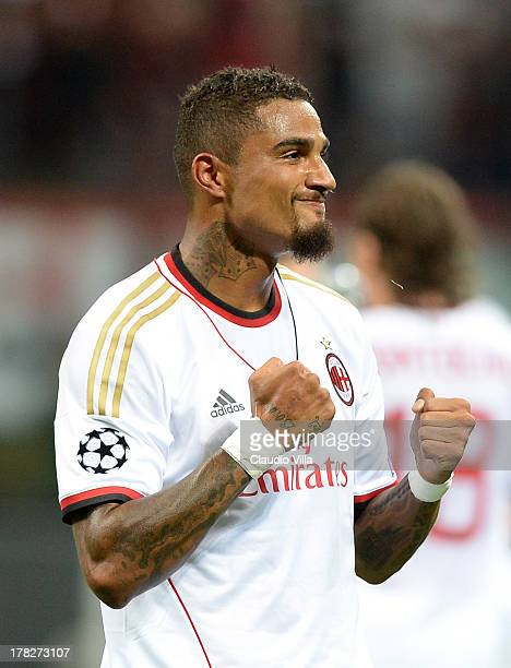 Kevin Prince Boateng of AC Milan celebrates scoring the first goal during the UEFA Champions League Playoff Second Leg match between AC Milan v PSV...