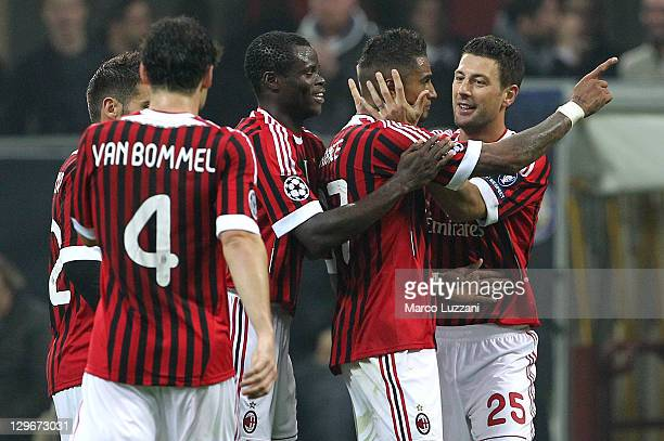Kevin Prince Boateng of AC Milan celebrates with his team-mates after scoring during the UEFA Champions League group H match between AC Milan and FC...