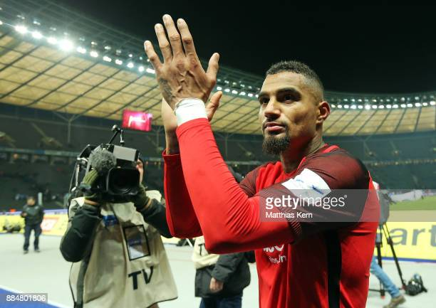 Kevin Prince Boateng of Frankfurt celebrates with his supporters after winning the Bundesliga match between Hertha BSC and Eintracht Frankfurt at...