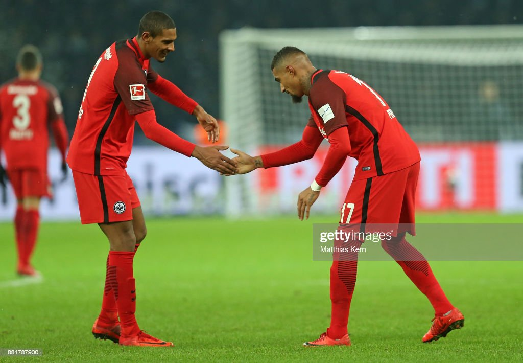 Kevin Prince Boateng (R) of Frankfurt jubilates with team mate Sebastien Haller after scoring the third goal during the Bundesliga match between Hertha BSC and Eintracht Frankfurt at Olympiastadion on December 3, 2017 in Berlin, Germany.