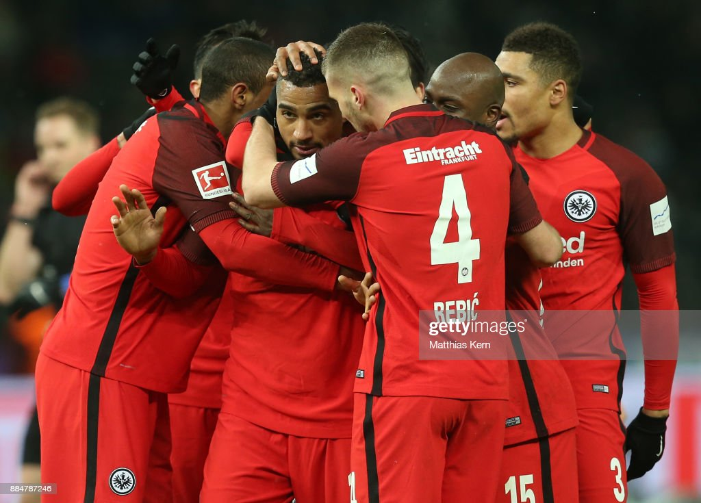 Kevin Prince Boateng (C) of Frankfurt jubilates with team mates after scoring the third goal during the Bundesliga match between Hertha BSC and Eintracht Frankfurt at Olympiastadion on December 3, 2017 in Berlin, Germany.