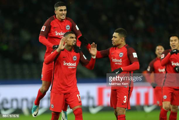 Kevin Prince Boateng of Frankfurt jubilates with team mates after scoring the third goal during the Bundesliga match between Hertha BSC and Eintracht...