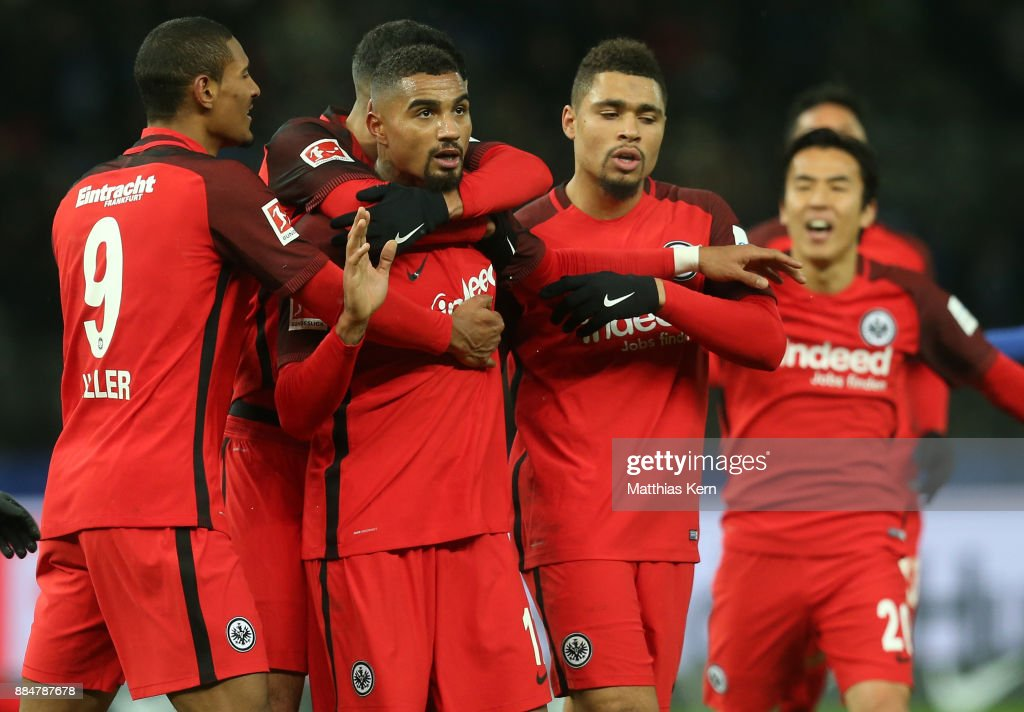 Kevin Prince Boateng (L) of Frankfurt jubilates with team mates after scoring the third goal during the Bundesliga match between Hertha BSC and Eintracht Frankfurt at Olympiastadion on December 3, 2017 in Berlin, Germany.