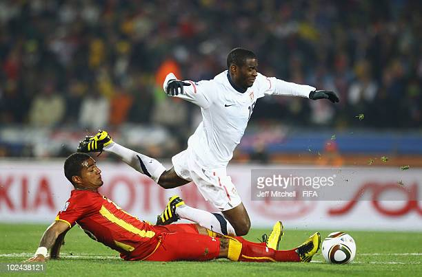 Kevin Prince Boateng of Ghana tackles Maurice Edu of the United States during the 2010 FIFA World Cup South Africa Round of Sixteen match between USA...