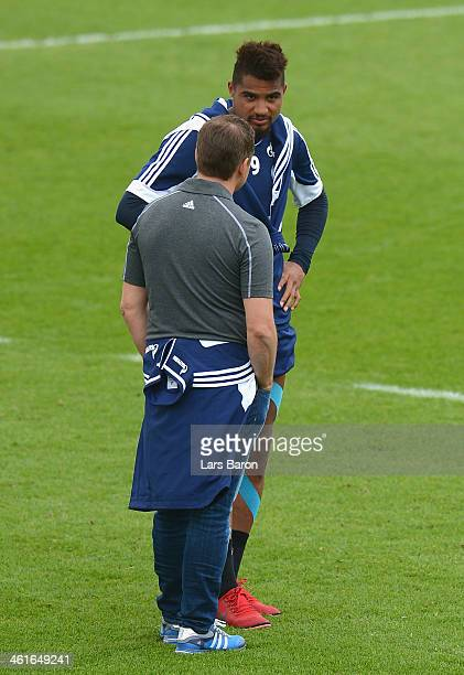 Kevin Prince Boateng speaks with manager Horst Held during a FC Schalke 04 training session at ASPIRE Academy for Sports Excellence on January 10...