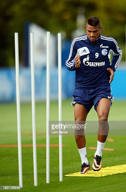 Kevin Prince Boateng warms up during a FC Schalke 04 training session on September 9 2013 in Gelsenkirchen Germany