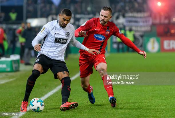 Kevin PrinceBoateng of Eintracht Frankfurt in action against John Verhoek of Heidenheim during the DFB Cup match between 1 FC Heidenheim and...