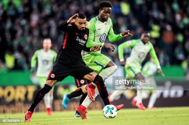 Kevin PrinceBoateng of Eintracht Frankfurt in action with Divock Origi of VfL Wolfsburg during the Bundesliga match between VfL Wolfsburg and...