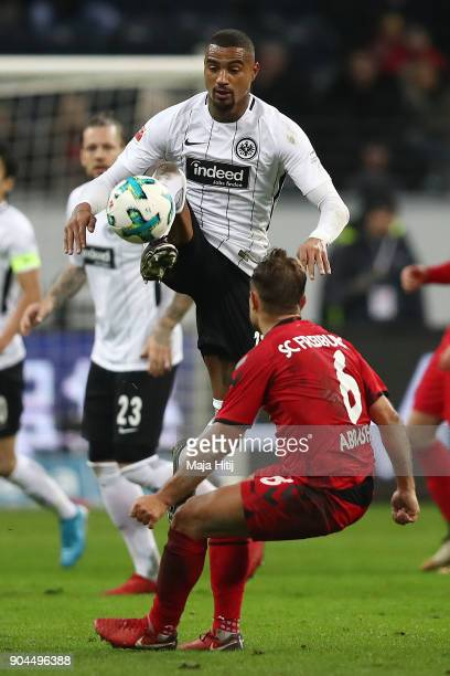 Kevin PrinceBoateng of Frankfurt fights for the ball with Amir Abrashi of Freiburg during the Bundesliga match between Eintracht Frankfurt and...