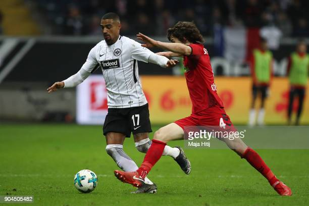 Kevin PrinceBoateng of Frankfurt fights for the ball with Caglar Soeyuencue of Freiburg during the Bundesliga match between Eintracht Frankfurt and...