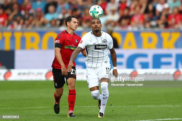 Kevin PrinceBoateng of Frankfurt with Nicolas Hoefler of FC Freiburg during the Bundesliga match between SportClub Freiburg and Eintracht Frankfurt...