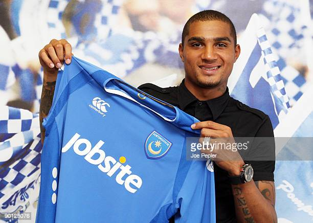 Kevin Prince-Boateng poses as he signs a three year deal with Portsmouth FC at Fratton Park on August 28, 2009 in Portsmouth, England.
