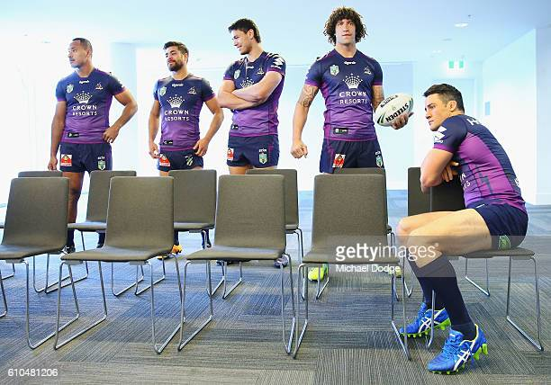 Kevin Proctor and Cooper Cronk wait for the team photograph to take place during a Melbourne Storm NRL media opportunity at AAMI Park on September 26...