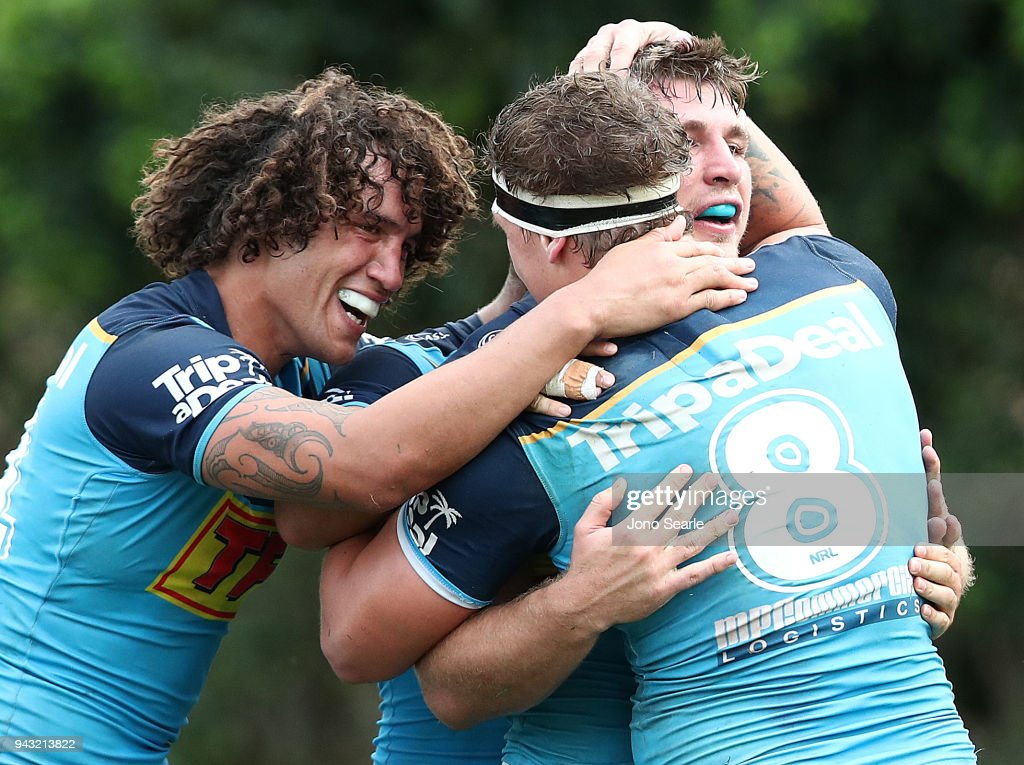 Kevin Proctor, Jarrod Wallace and Jai Arrow of the Titans celebrate the winning try during the round five NRL match between the Gold Coast Titans and the Manly Sea Eagles at Marley Brown Oval on April 8, 2018 in Gladstone, Australia.