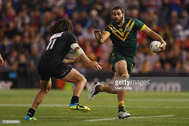 Kevin Proctor of the Kiwis attempts to tackle Greg Inglis of the Kangaroos during the International Rugby League Trans Tasman Test match between the...