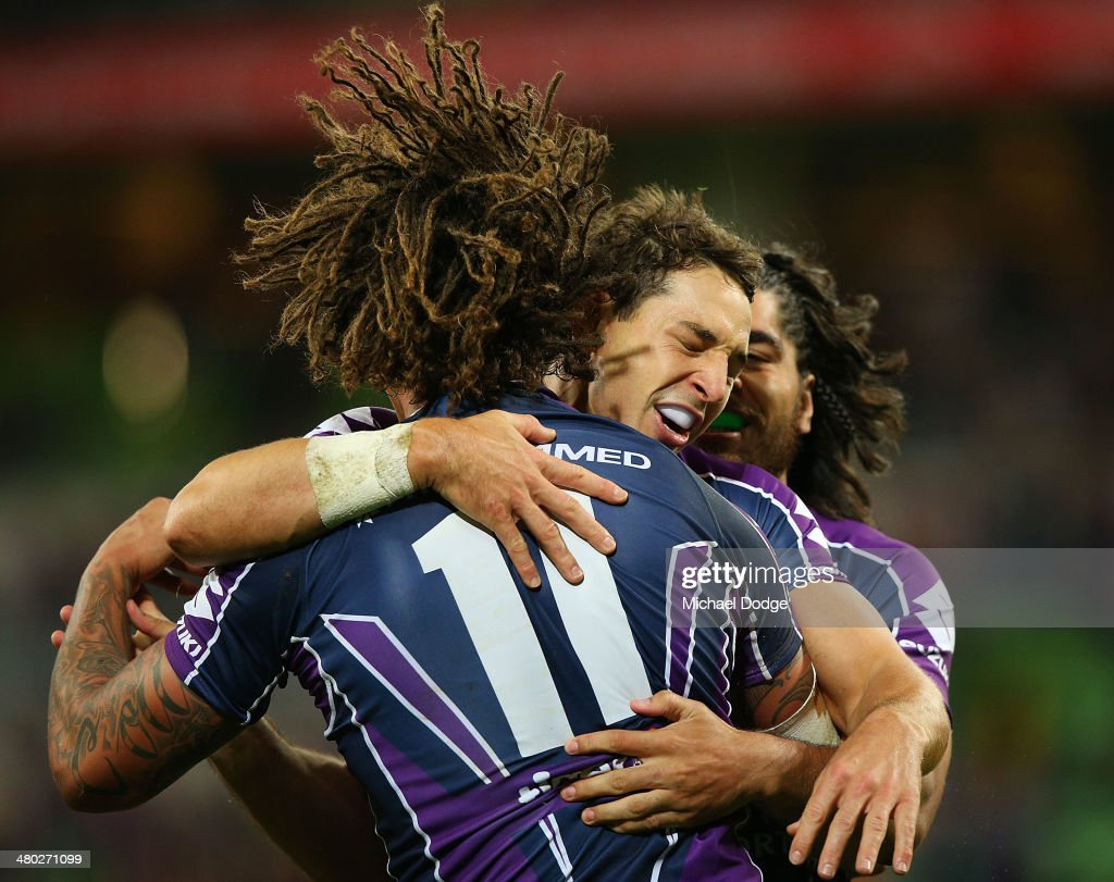 Kevin Proctor (L) of the Storm celebrates a try with Billy Slater (C) during the round three NRL match between the Melbourne Storm and the Newcastle Knights at AAMI Park on March 24, 2014 in Melbourne, Australia.