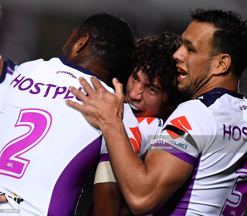Kevin Proctor (c) of the Storm celebrates after scoring a try during the round 21 NRL match between the North Queensland Cowboys and the Melbourne Storm at 1300SMILES Stadium on July 30, 2016 in Townsville, Australia.