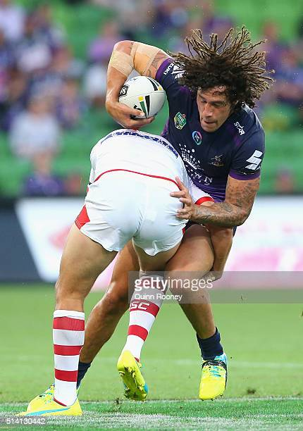 Kevin Proctor of the Storm is tackled by Gareth Widdop of the Dragons during the round one NRL match between the Melbourne Storm and the St George...