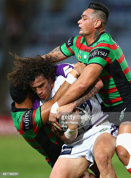 Kevin Proctor of the Storm is tackled by John Sutton of the Rabbitohs during the round 10 NRL match between the South Sydney Rabbitohs and the...