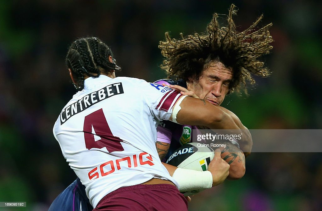 Kevin Proctor of the Storm is tackled by Steve Matai of the Sea Eagles during the round 10 NRL match between the Melbourne Storm and the Manly Sea Eagles at AAMI Park on May 20, 2013 in Melbourne, Australia.