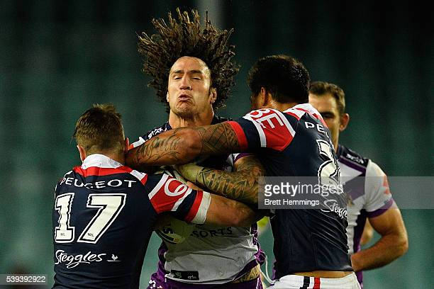 Kevin Proctor of the Storm is tackled during the round 14 NRL match between the Sydney Roosters and the Melbourne Storm at Allianz Stadium on June 11...