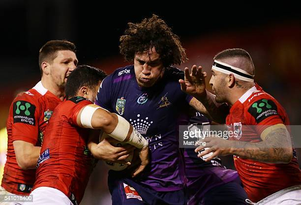 Kevin Proctor of the Storm is tackled during the round 15 NRL match between the St George Illawarra Dragons and the Melbourne Storm at WIN Stadium on...