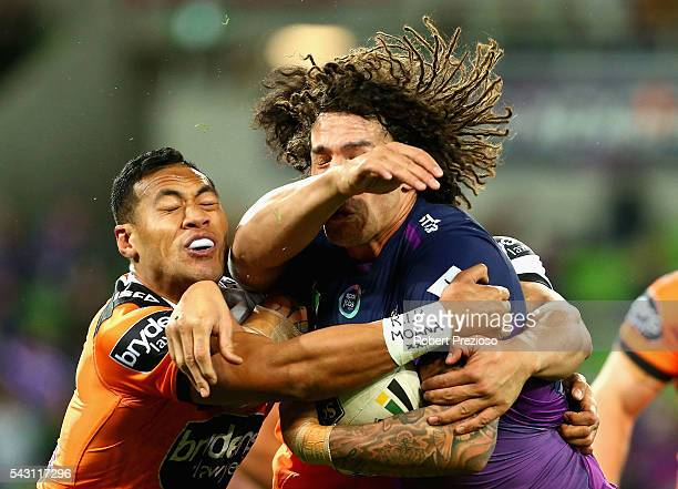 Kevin Proctor of the Storm is tackled during the round 16 NRL match between the Melbourne Storm and Wests Tigers at AAMI Park on June 26 2016 in...