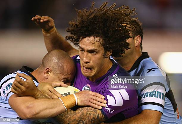 Kevin Proctor of the Storm is tackled during the round 23 NRL match between the Cronulla Sharks and the Melbourne Storm at Remondis Stadium on August...